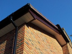 Rosewood fascia white tongue and groove soffit UPVC round guttering