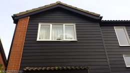 hardiplank cladding with upvc black ash fascias soffits