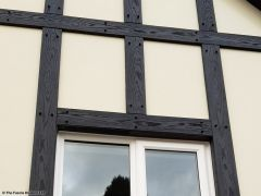 Install new mock tudor beams with cream composite render panels