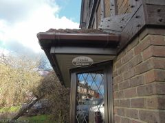 Brown square guttering, rosewood fascia, white soffit and Replica Wood oak tudor beams replacement
