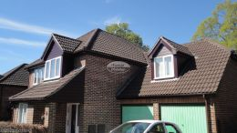 New rosewood UPVC shiplap cladding, fascias, soffits and UPVC brown guttering