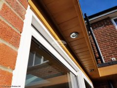 Replace fascias and soffits and install new LED lighting