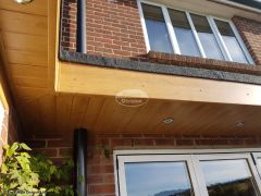 Replace flat roof, fascias and soffits and install LED lighting