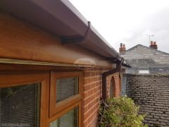 Replacement UPVC oak fascia with brown square guttering