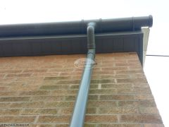 UPVC grey downpipe with grey soffit and fascia installation