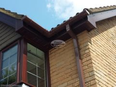 UPVC woodgrain soffit and fascia with brown square guttering replacement