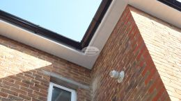 white UPVC tongue and groove soffit with black guttering