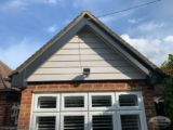 Gable end with Hardieplank cladding and grey fascia board